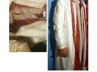 Red and white Sherwani