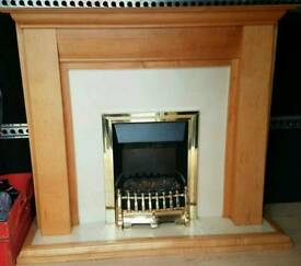Fire place with electric fire