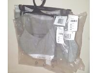 Grey Calvin Klein set. Medium size. It comes brand new with the orginal packaging.