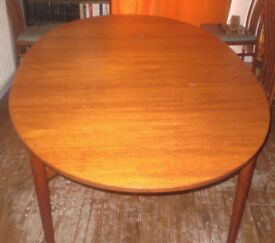 Large oval wooden dining table 78 x 48 inches with two extensions