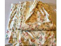 Elegant floral Laura Ashley curtains.