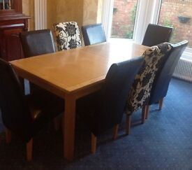 Dining Table & 8 Chairs - Table is Oak - 6 Black Chairs are Leather - 2 Fabric