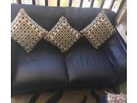 TWO SEATER LEATHER SOFA + SOFA CUSHIONS + SUN BED + COFFEE TABLE + BEAN BAG AND A BIG BROWN PILLOW