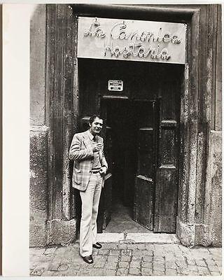 Large original vintage 1960s cool man standing at bar entrance