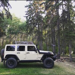Fully loaded lifted Jeep Wrangler Sahara Unlimited