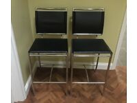 Two leather kitchen bar stools