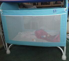Mothercare Travel Cot in blue stripe pattern