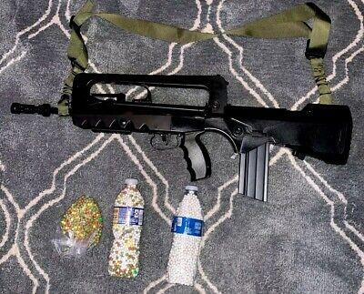FAMAS 350 FPS / 5000 BBS / GUN STRAP