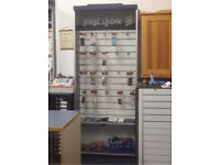 Tall display cabinet with slats built in