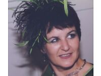 Beautiful black and green feather fascinator