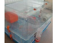 Hamster cage, exercise ball, hamster houses, water bottles, coconut house