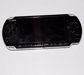 PSP with charger and game