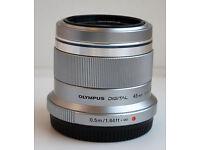 Olympus 45mm f/1.8 + lens hood