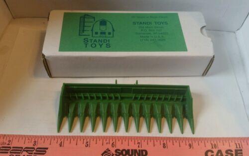 1/64 ERTL farm toy standi 12row corn head 4 John deere combines see desc details