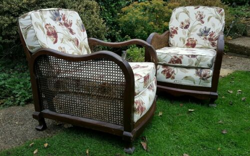 Pair of wooden framed armchairs