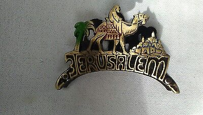 metal souvenier napkin holder from Jerusalem with a camel rider and palm tree