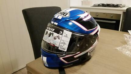 Shoei NXR Blue helmet Small new with paint protection.