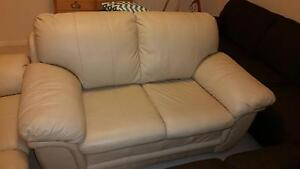 2 x 2 seater cream leather couches Quakers Hill Blacktown Area Preview