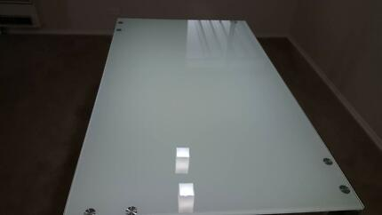 Glass dining table with chrome legs