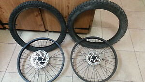 "Pair of 2.25"" x 20"" bicycle tires and rims"