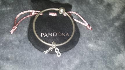 Pandora bangle and 2 charms