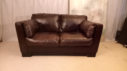 Chocolate brown warm 2 seater genuine leather sofa.  Can deliver