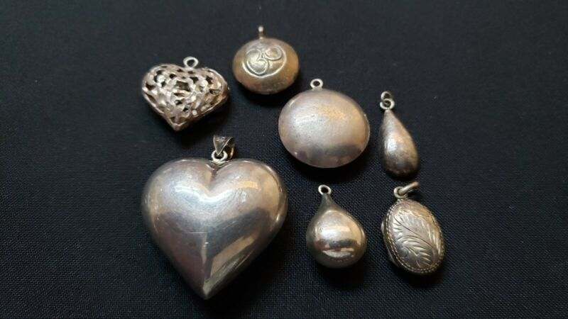 Lot of vintage puffy sterling silver pendants charms