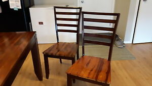 Beautiful butterfly wooden table with six matching chairs for sa