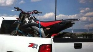 Looking for an enclosed trailer wanting to trade dirt bikes+