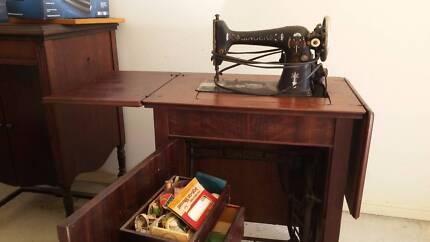 1 Treadle Sewing Machine/Cabinet