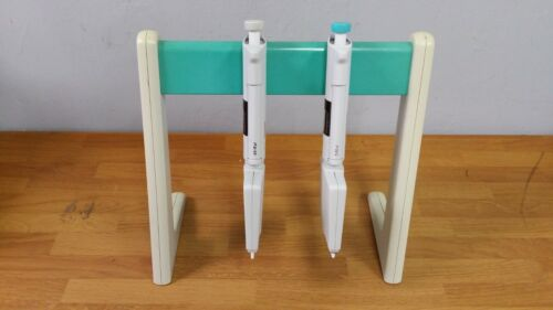 A set of 2 Thermo Finnpipette Adjustable Multi-Channel Pipettes with Stand