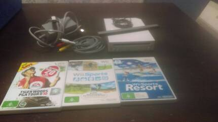 Wii Console White and 3 games.
