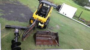 Mustang Skid Steer with Attachments