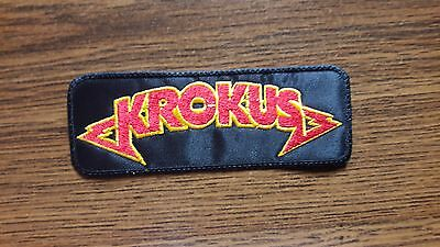 KROKUS,SEW ON RED WITH YELLOW EDGE EMBROIDERED PATCH
