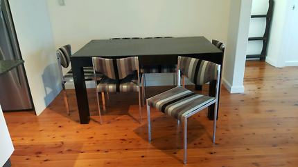 6 Seat Dining Table and 6 upholstered chairs.