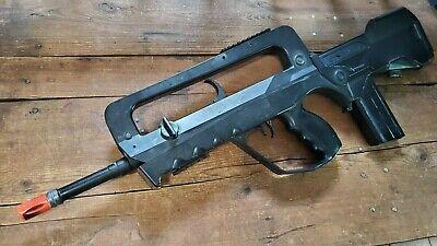 Cybergun FAMAS Airsoft Spring Bullpup Rifle, black spring rifle