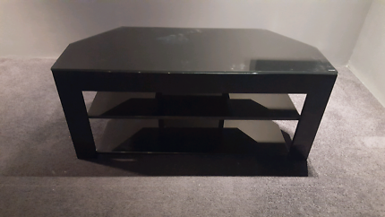 Tv unit with black tempered glass shelves