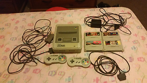 Super nintendo with cords and 4 games Berala Auburn Area Preview