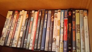 Box of vhs movies and dvds
