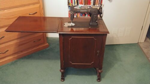 White Rotary 1927 sewing machine in bookcase with attachments