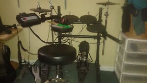 Roland TD-3 drums, Tama power glide 900 wood beaters, mapex seat