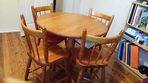 round wooden table with chairs Thornleigh Hornsby Area Preview