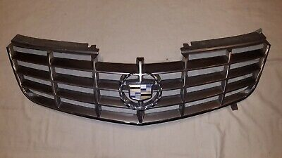 06-11 Cadillac DTS Grille Bumper Mounted w/ Emblem Grill OEM