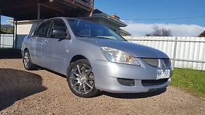 2005 Mitsubishi Lancer Sedan ES CH with aftermarket sound system Lavington Albury Area Preview