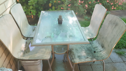 Outdoor glass table with 4 chairs