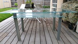 Glass indoor/outdoor dining table