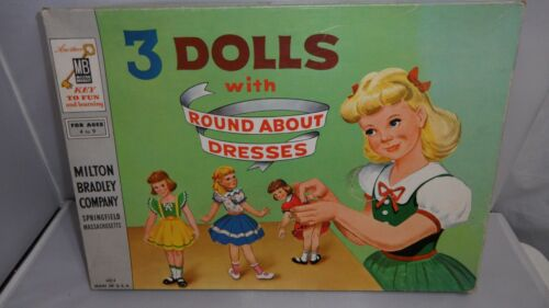 #4414  3 DOLLS WITH ROUND ABOUT DRESSES  PARTIALLY CUT  MISSING 1 DOLL STAND  MI