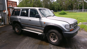 Land cruiser GXL 80 series Petrol 8 seater White Rock Cairns City Preview