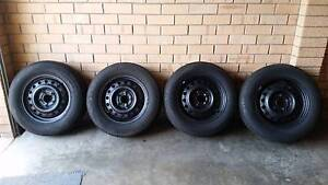 BARGAIN SET COMMODORE 15INCH WHEELS WITH 85%205 65 15 INCH TYRES Surfers Paradise Gold Coast City Preview