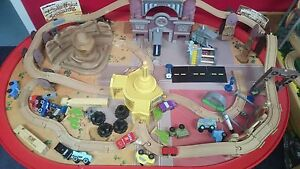 Wooden Train set with Disney 'Cars' characters.